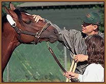 Victory Gallop and his trainer, Elliot Walden.